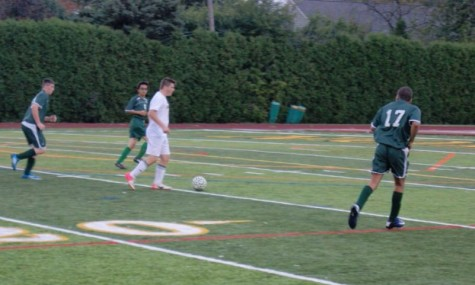 Senior Michael Paret dribbles around players in their first playoff game against East Detroit