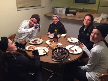The girls varsity golf team shares breakfast together during their weekend at states.