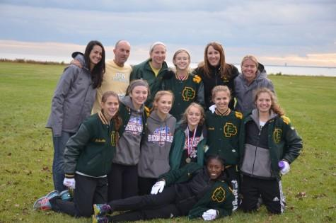 Girls cross country crosses finish line to states