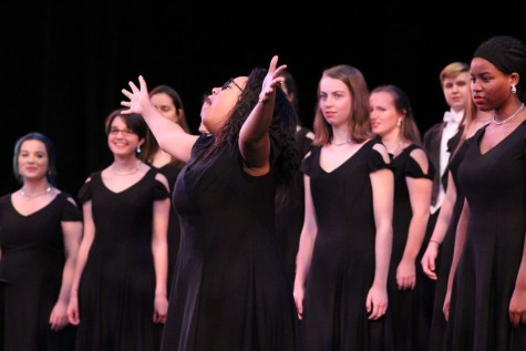 Senior Raina Martin acts out a solo during Pointe Chorale