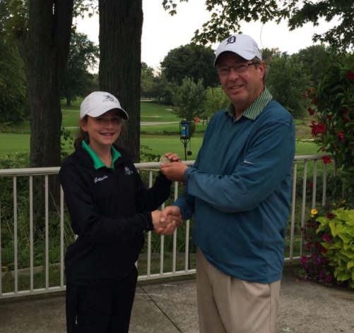 Girls golf coach Pete Kingsley (right) with sophomore Megan Gallagher (left) after a match.