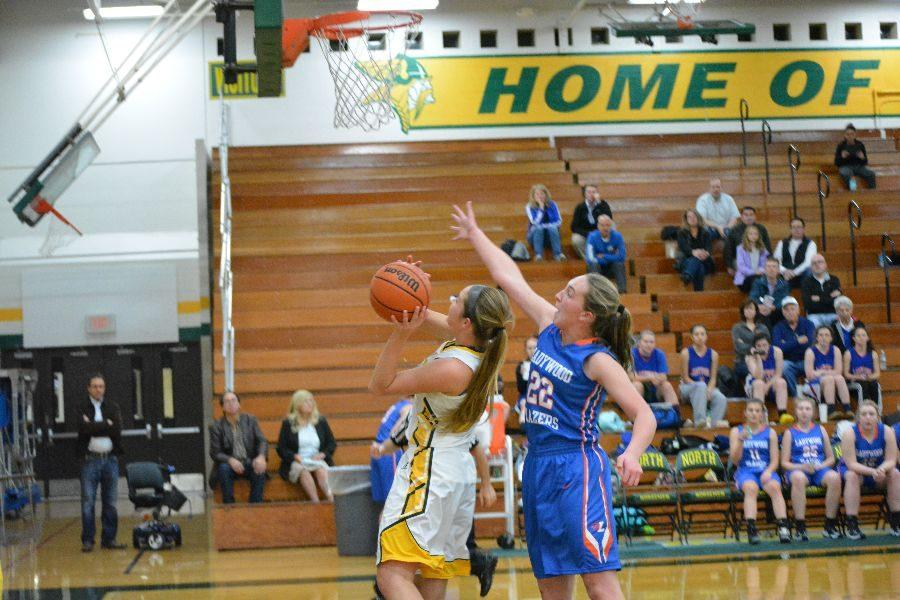 Gaining+two+points%2C+senior+Katie+Snow+goes+in+for+a+lay+up.