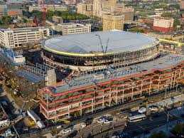 Ongoing constructing of Little Ceasars Arena in downtown Detroit. Costs have exceeded 700 million dollars.