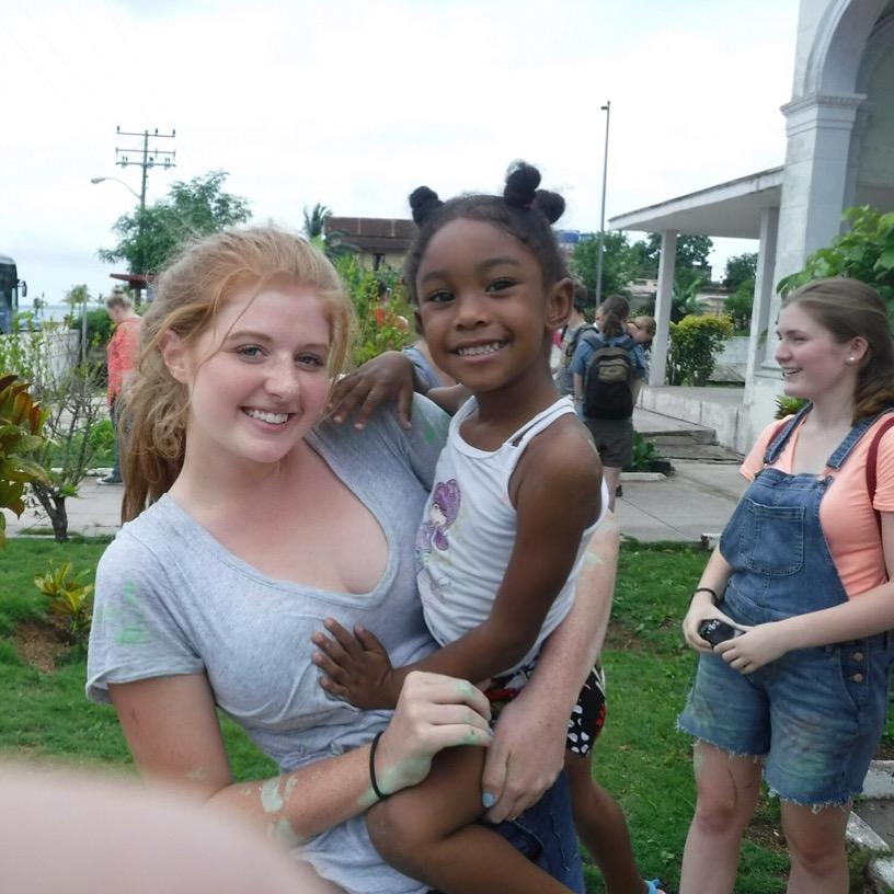 Sophomore+Noelle+Conrad+volunteers+at+a+Cuban+orphanage+while+on+the+mission+trip.