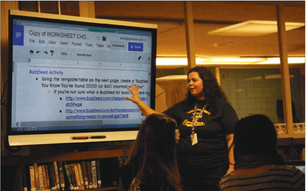 Library media specialist Amanda Pata presents to freshmen in the library. The library has not had any major renovations since the school was originally built.