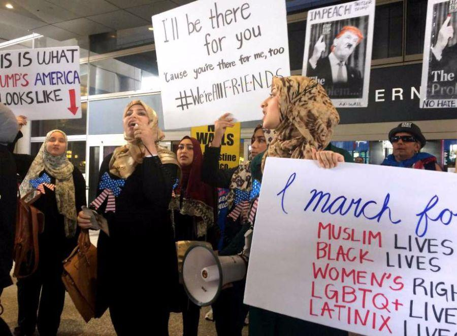 Protesters against Trump's travel ban stood up together in different places, especially airports.