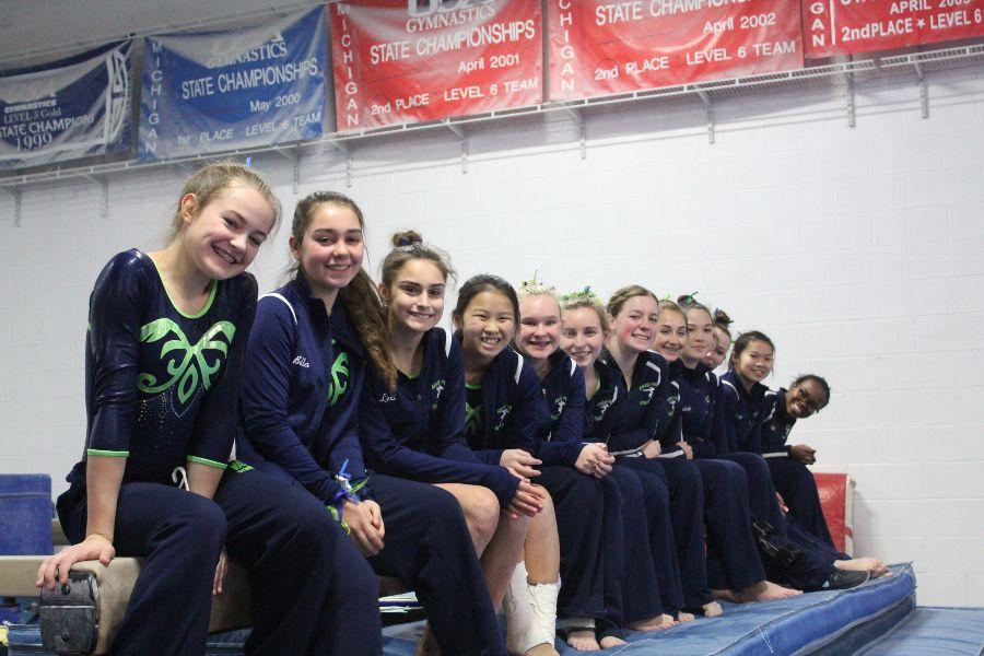 Members of the Grosse Pointe United gymnastics team pose for a picture together during one of their meets.
