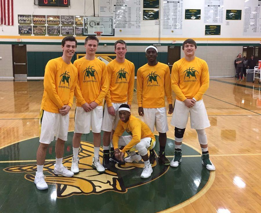 The seniors of the varsity basketball team after their senior night game