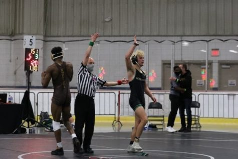 """Senior Logan Ladach agreed with his coach Jaron Nelson, saying that this is not the end of his wrestling career, or at least he hopes not. """"My high school wrestling career is over but I'm actively going on college visits to wrestle in college,"""" Ladach said."""