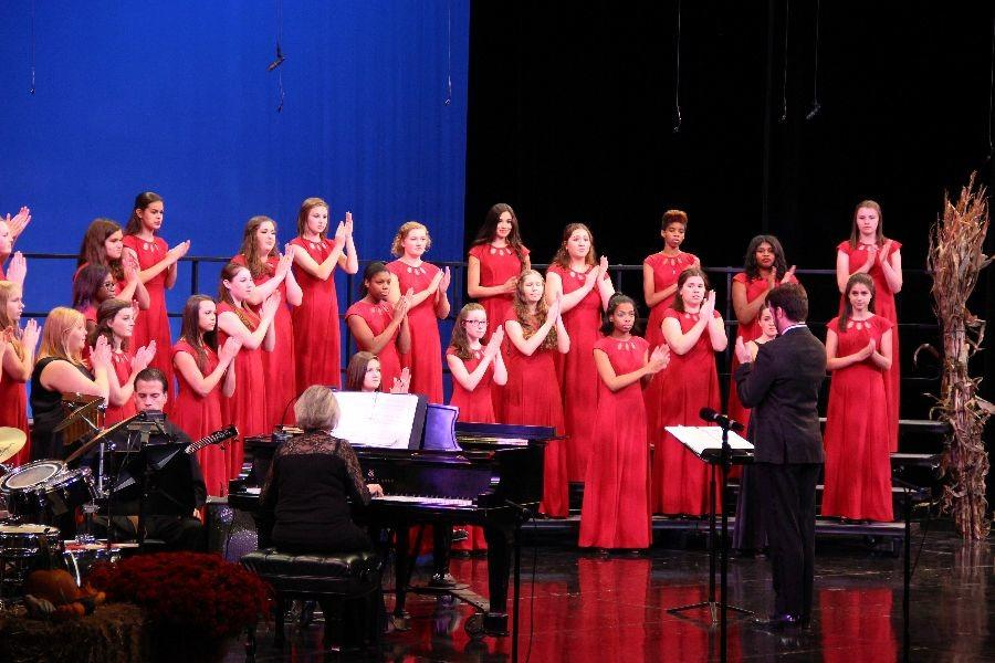 Choraliers perform with synchronized clapping during their second song