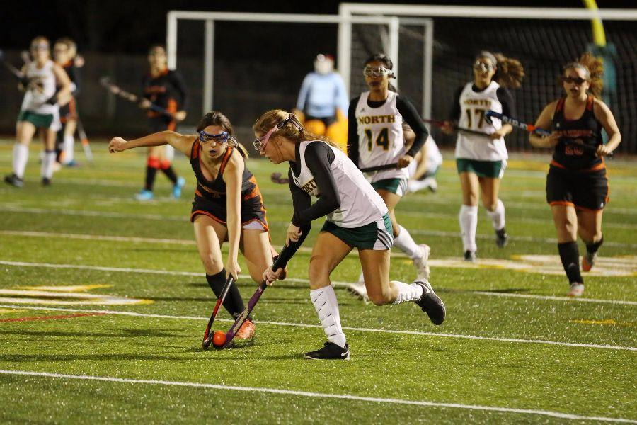 Senior Olivia Kensora moves the ball up the field.