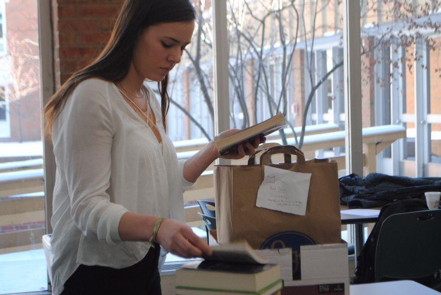 Senior and Interact Club president Lauren Beach packs books together.