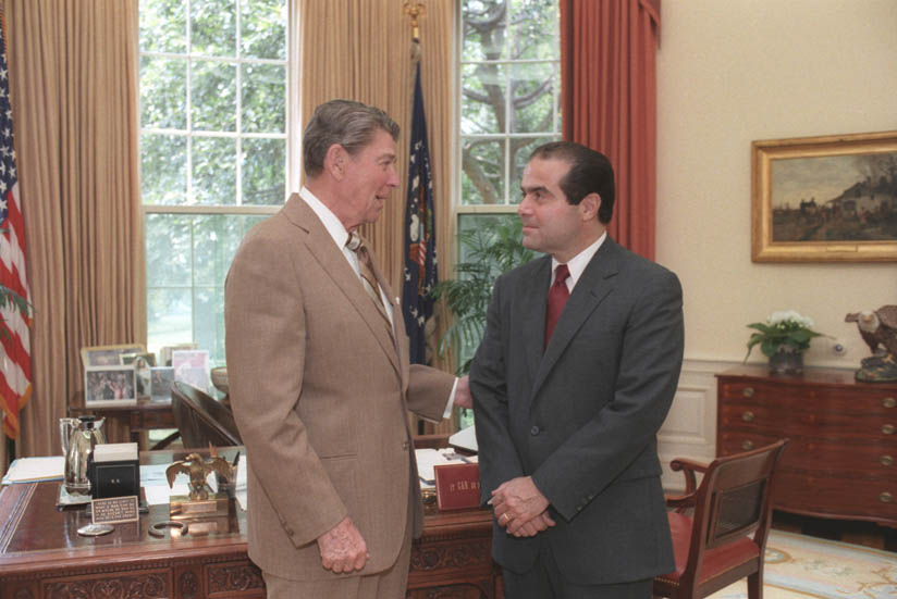 Former President Ronald Reagan, left, alongside Supreme Court Justice Antonin Scalia, right, in the White House. Scalia died on Feb. 13 at age 79.