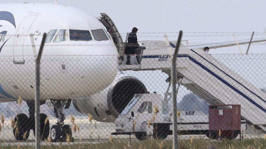 An EgyptAir passenger exiting MS181 after authorities arrested a hijacker.