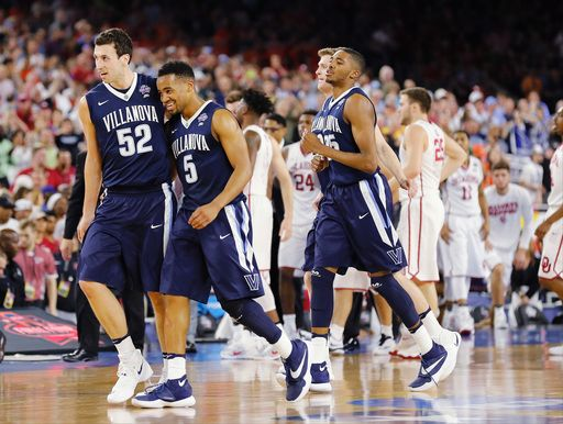 Villanova players including Phil Booth, center, and Kevin Rafferty, left, walk off the court after a blowout win against Oklahoma, 95-51, Saturday night.