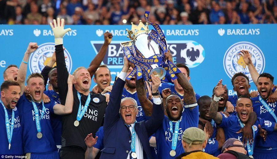 Leicester+City+hoisting+their+trophy+after+winning+the+English+Premier+League.+