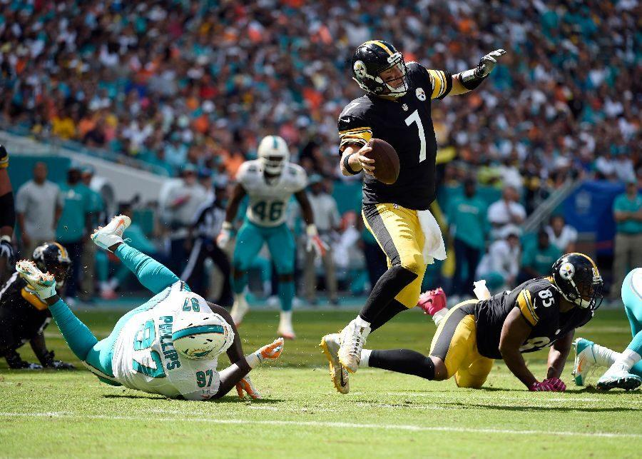 Ben Roethlisberger (7) being tripped up by Miami Dolphin Jordan Phillips (97) during the Steelers' week six matchup.