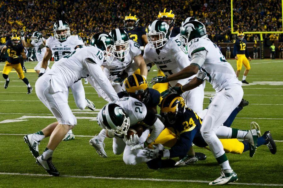 THE BIG GAME | Michigan State Spartans defensive back Jalen Watts-Jackson (20) dives into the end zone for a game winning touchdown as the clock runs out in the fourth quarter against the Michigan Wolverines at the Big House last season.