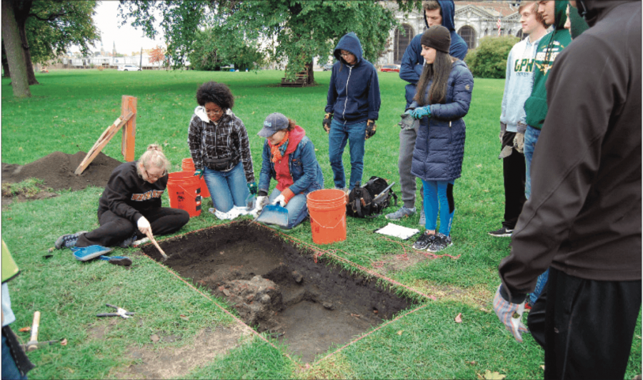 """DIGGING IN THE D   Anthropology students dig in hopes of  nding buried artifacts. """"We got down and dirty in the mud, and (we got to) really dig up some of the old past of Detroit, so it was lots of fun,"""" senior Garrett Clark said."""