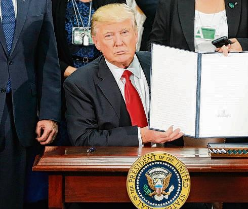 President Trump signed an executive order restricting the issuing of new visas to travelers from seven Muslim countries.