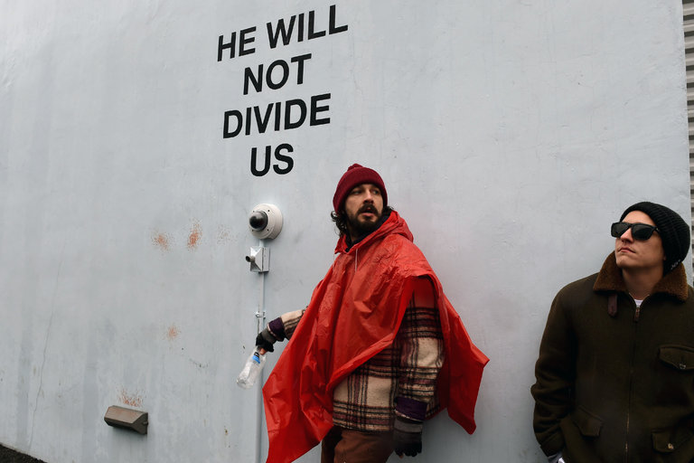 Shia+Labeouf%2C+left%2C+pictured+at+one+of+his+livestreams+near+the+Museum+of+Moving+Image+in+Queens%2C+New+York.+