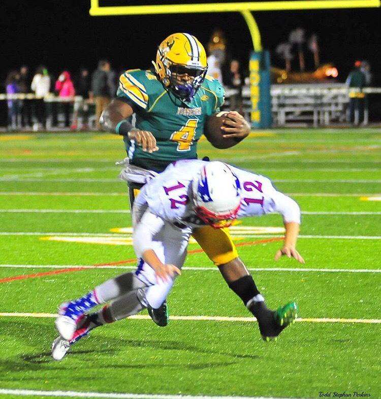 Senior Jared Jordan runs around a player during a game. Jordan committed to Sienna Heights University on Feb. 2.