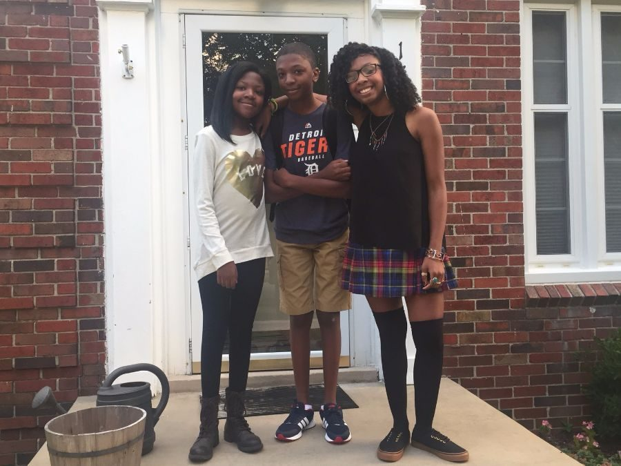 Senior LaSean Patton with her siblings. Patton is the concertmaster of the school orchestra.