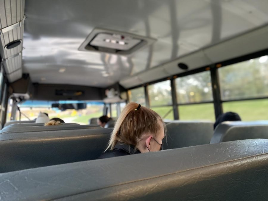 "The girls lacrosse team leaves space between seats on the bus ride to Troy Athens. ""The number of players is lower this season than in past seasons but that's because of a lot of factors,"" Nixon said."