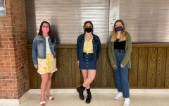 Senior Emily McCloskey, sophomore Isabella Yoakam and senior Eliza Ellery don different denim clothes to participate in Denim Day. Ellery said that the purpose of wearing denim was to spread awareness of important issues in the community.