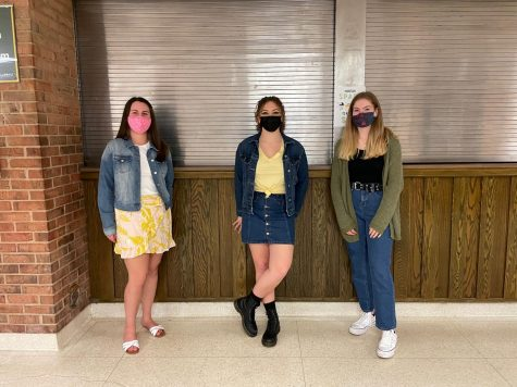"""Senior Emily McCloskey, sophomore Isabella Yoakam and senior Eliza Ellery don different denim clothes to participate in Denim Day. Ellery said that the purpose of wearing denim was to spread awareness of important issues in the community. """"The purpose of denim day was to spread awareness of and take a stand against sexual assault harassment,"""" Ellery said."""